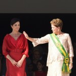 Brazil's President Dilma Rousseff (R) waves next to her daughter Paula during her second term inauguration in Brasilia, on January 1, 2015. The 67-year-old left-wing former urban guerrilla begins her second term Thursday, aiming to get economic growth back on track, and to rebuild government credibility after a major kickbacks scandal. AFP PHOTO/EVARISTO SA